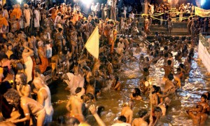 TO GO WITH: India-religion-festival-Kumbh, ADVANCER by Aditya PHATAK (FILES) In this photograph taken on August 12, 2003, Indian Sadhus and devotees bathe in the dipping tank during the early hours of the morning during a ceremony at a holy ghat at Trimbakeshvara on the outskirts of Nashik, celebrating the Kumbh Mela. India's mass Hindu pilgrimage the Kumbh Mela officially starts in Maharashtra state on July 14, 2015,  with organisers desperate to avoid a repeat of a deadly stampede at the same venue 12 years ago. Thirty-nine pilgrims were trampled to death and more than 50 others injured when the religious festival was last held on the banks of the Godavari river at Nashik in 2003.   AFP PHOTO/Rob ELLIOTT/FILESROB ELLIOTT/AFP/Getty Images