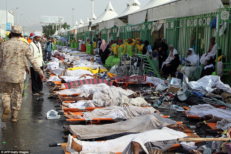 Horrific_Saudi_emergency_personnel_stand_near_bodies_of_Hajj