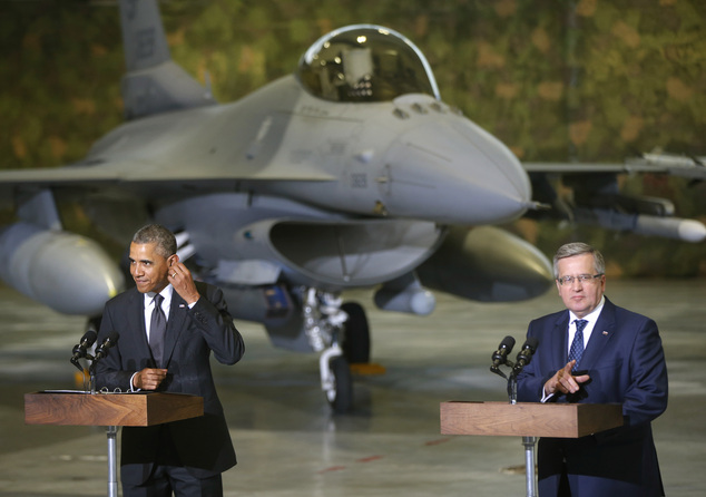 U.S. President Barack Obama and Poland's President Bronislaw Komorowski make statements and meet with U.S. and Polish troops at an event featuring four F-16 fighter jets, two American and two Polish, as part of multinational military exercises, in Warsaw, Poland, Tuesday, June 3, 2014. (AP Photo/Charles Dharapak)