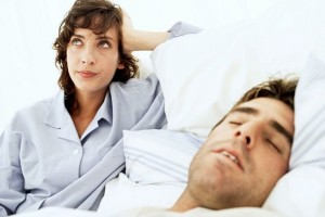 woman-frustrated-at-mans-snoring
